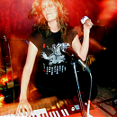 a photo of Krista Bones of Raised by Wolves playing the organ at the Candy Bar